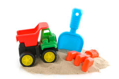 Plastic toys at the beach stock photo