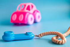 Plastic toys on a blue background for children. Stock Images