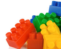 Plastic toys and bricks isolated on white Stock Photos