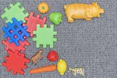 Plastic toys on the carpet. Plastic toys for the farm on the carpet in the form of a frame stock image