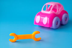 Plastic toys for children on a blue background Royalty Free Stock Image