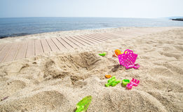 Plastic toys on the sand Royalty Free Stock Image