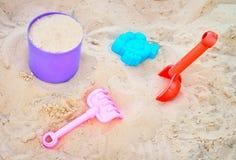 Plastic toys on a sand. Sandbox Stock Photo