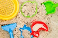 Plastic toys in sandpit Stock Image