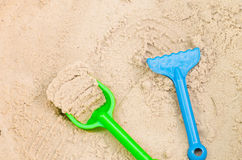 Plastic toys in sandpit Stock Photography