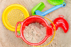 Plastic toys in sandpit Royalty Free Stock Images
