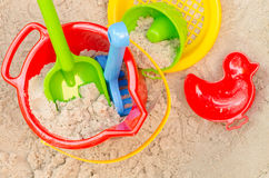 Plastic toys in sandpit Stock Images