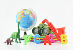 Plastic toys on white background, children explore concept Stock Image