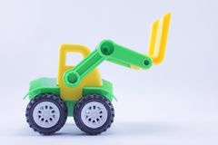 Plastic tractor. On white background Stock Photo