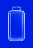 Plastic transparent container on blue Royalty Free Stock Image