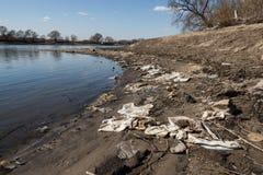 Plastic trash along the coastline. Environmental pollution. royalty free stock photography
