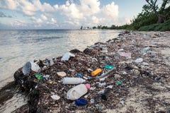 Plastic Trash on Caribbean Beach Stock Image
