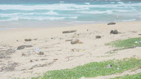 Plastic trash and other marine garbage on tropical sandy beach stock video footage