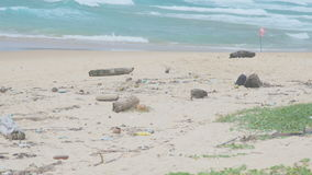 Plastic trash and other marine garbage on tropical sandy beach stock video