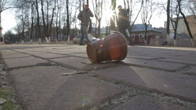 Plastic trash on the pavement. A cup falls on the pavement stock video