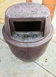 Plastic trashcan with the black stain. Royalty Free Stock Photos