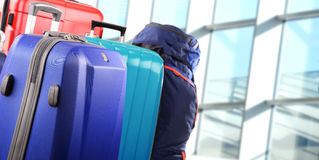 Plastic travel suitcases in the airport hall Stock Photography