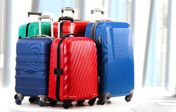 Plastic travel suitcases in the airport hall Stock Image