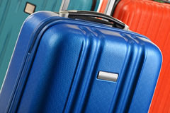 Plastic travel suitcases. Hand luggage Royalty Free Stock Image