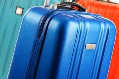 Plastic travel suitcases. Hand luggage Stock Photo