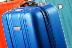 Plastic travel suitcases. Hand luggage Stock Image