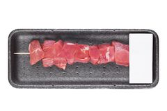 Plastic tray with fresh raw pork beef kebab. On wooden stick with label Royalty Free Stock Photos
