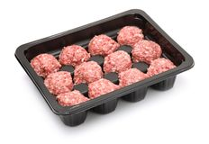 Plastic tray with raw beef meatballs Stock Photography