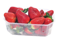 A plastic tray with strawberries Stock Images