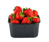 Plastic tray with strawberries Royalty Free Stock Images