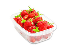 Plastic tray with strawberries Stock Images