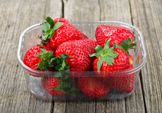 Plastic tray with strawberries Royalty Free Stock Photos
