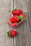 Plastic tray with sweet strawberries Royalty Free Stock Photos