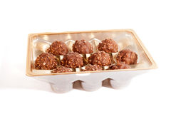 A plastic tray with ten milk chocolate sweets Stock Photo