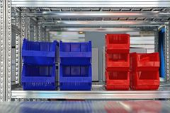 Sorting Trays Shelf. Plastic Trays for Sorting at Shelf in Storage Room royalty free stock photos