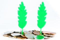 Plastic trees and money. Royalty Free Stock Photos