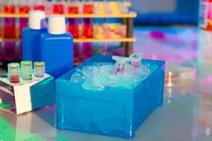 Plastic tube in a box full of ice Royalty Free Stock Images