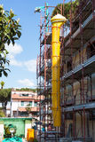 Plastic tube for debris dumping mounted on a scaffold Royalty Free Stock Photo
