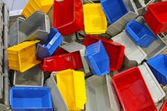 Plastic tubs and bins. Big bunch of colorful plastic sorting bins and tubs stock photo