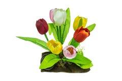 Plastic tulips on wood. Isolate on white background Stock Photo