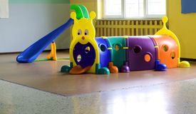 Plastic tunnel for children's play in nursery furniture Stock Image