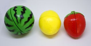 Plastic vegetables and fruits. Plastic fruits in colors of traffic lights Stock Image