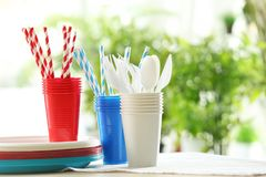 Plastic ware on table. Outdoors stock image
