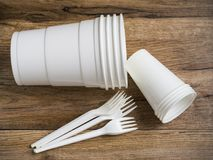 Plastic ware. On wood background royalty free stock photography