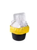 Plastic waste in the black bucket. Separate garbage collection. Plastic pack waste in the black bucket and yellow plastic bag isolated on white Royalty Free Stock Photography