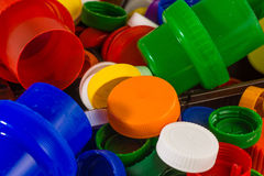 Plastic waste. Lots of colorful plastic caps Stock Photos
