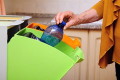 Plastic waste sorting. Woman doing plastic waste sorting at home Royalty Free Stock Photo