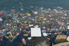 Plastic waste in river stock images