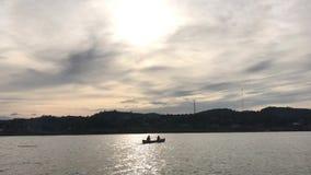 People Canoeing on River in the lake at Sunset, Sangkhla Buri,Kanchanaburi, Thailand. stock footage
