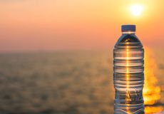 Plastic water bottle. With blue cap on sky background stock image