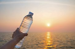 Plastic water bottle. With blue cap on sky background stock images